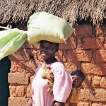 Mother with bag of maize